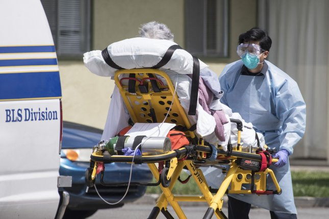 A patient is moved out of Gateway Care and Rehabilitation Center, a skilled nursing facility in Hayward, Calif., on Thursday. Photo by Terry Schmitt/UPI