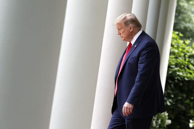 U.S. President Donald Trump arrives in the Rose Garden on Friday to announce the termination of the United States' relationship with the World Health Organization. Photo by Yuri Gripas/UPI