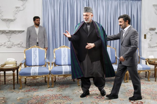 Iranian President Mahmoud Ahmadinejad (R) greets Afghan president Hamid Karzai during an official meeting in Tehran, Iran on March 26,2011. The purpose of Karzai visit is to attend a ceremony to mark the Persian New Year. UPI/Maryam Rahmanian