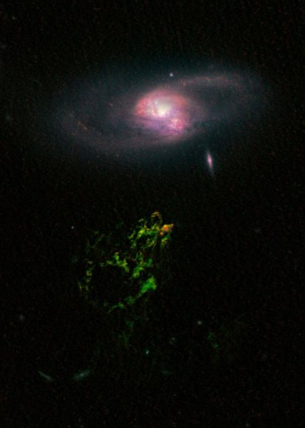 This April 12, 2010 NASA image taken by the Hubble Space Telescope shows the Hanny's Voorwerp, a 300,000-light-year-long streamer of gas stretching around the galaxy, called IC 2947. The greenish Voorwerp is visible because a beam of light from the galaxy's core illuminates it. This beam came from a quasar--a bright, energetic object powered by a black hole. The quasar may have turned off about 200,000 years ago. UPI/NASA