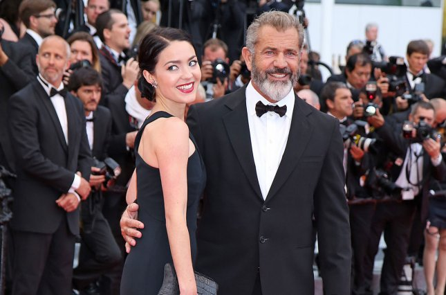 "Mel Gibson (R) and Rossalind Ross arrive on the red carpet before the closing ceremony of the 69th annual Cannes International Film Festival on May 22, 2016. When asked about his upcoming child with Ross, Gibson stated in a new interview, I think my adrenals are worn out so I don't even react anymore."" File Photo by David Silpa/UPI"