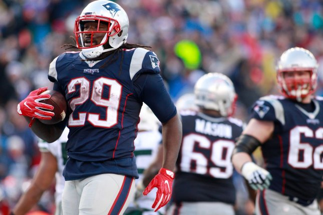 New England Patriots running back LeGarrette Blount (29) walks into the end zone after scoring on a one-yard touchdown in the third quarter against the New York Jets at Gillette Stadium in Foxborough, Massachusetts on December 24, 2016. Photo by Matthew Healey/ UPI