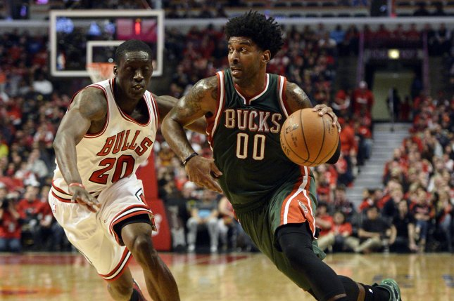 Milwaukee Bucks guard O.J. Mayo (R) drives on former Chicago Bulls guard Tony Snell during the second quarter. File photo by Brian Kersey/UPI