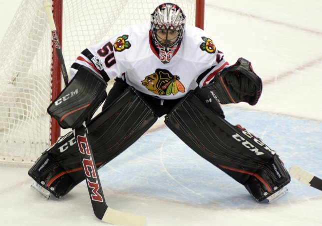 Corey Crawford and the Chicago Blackhawks held off the Minnesota Wild on Saturday. Photo by Archie Carpenter/UPI