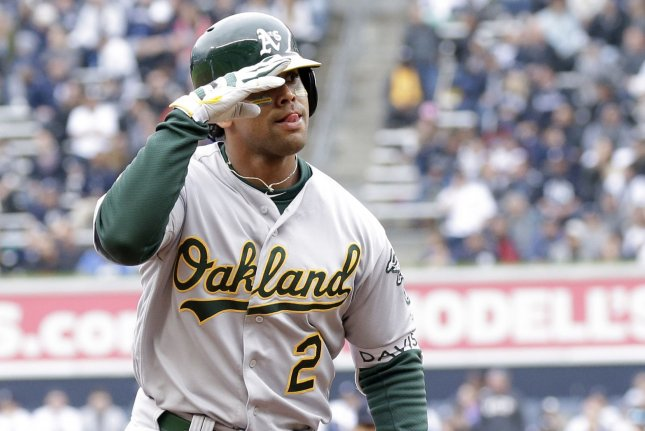 Oakland Athletics hitter Khris Davis reacts as he runs the bases after hitting a three-run home run in the fourth inning against the New York Yankees on May 12, 2018 at Yankee Stadium in New York City. Photo by John Angelillo/UPI
