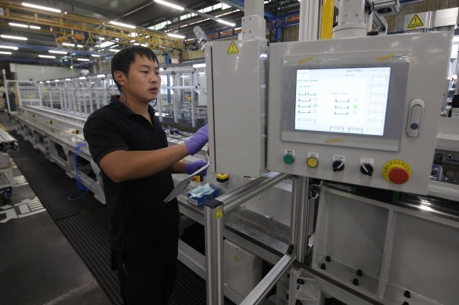 Chinese employees work at Festo's manufacturing headquarters in Jinan, China, in October 2019. The coronavirus outbreak in China is significantly impacting U.S. manufacturing growth, data showed Monday. File photo by Stephen Shaver/UPI