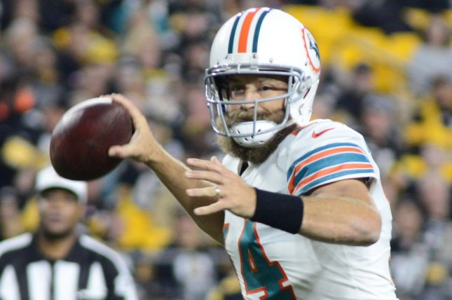 Miami Dolphins quarterback Ryan Fitzpatrick (14) was demoted on Tuesday to a backup role and now questions his future as an NFL starter. File Photo by Archie Carpenter/UPI