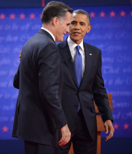 President Barack Obama speaks with Republican presidential candidate Mitt Romney after the first Presidential Debate of 2012 at the University of Denver on October 3, 2012 in Denver, Colorado. The first of three debates will focus on domestic policy. UPI/Kevin Dietsch