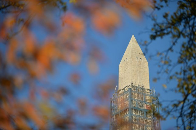 The Washington Monument is seen framed by fall foliage as workers continue to remove scaffolding after repairing damage caused by the 2011 earthquake, in Washington, D.C., November 19, 2013. The $15 million, two-year, project is winding down after crews repaired large cracks in the Monument. UPI/Kevin Dietsch