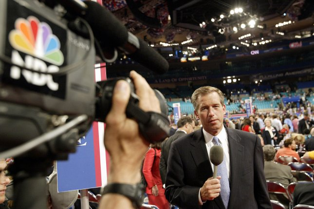 Brian Williams prepares for a live shot during the 2004 Republican National Convention at Madison Square Garden in New York City. Photo: Bill Greenblatt/UPI