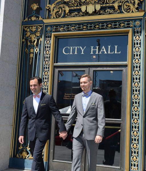 A newly married couple exits City Hall in San Francisco, June 26, 2015. The US Supreme Court's ruled gay marriage legal in all 50 states today. Photo by Terry Schmitt/UPI