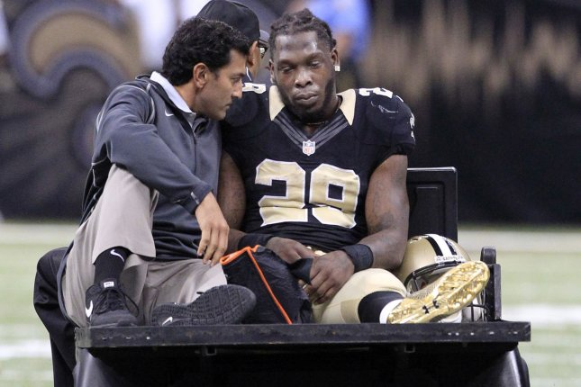 New Orleans Saints running back Khiry Robinson (29) leaves the field with a broken leg during the second quarter at the Mercedes-Benz Superdome in New Orleans November 1, 2015. Photo by AJ Sisco/UPI