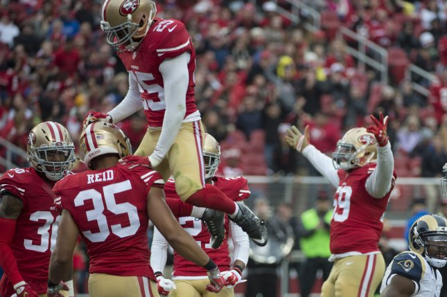 ce972d778 San Francisco 49ers  Eric Reid (35) is congratulated by Tramaine Brock (25)  after Reid broke up a St. Louis Rams pass in the second quarter at Levi s  ...