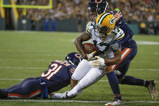 Green Bay Packers wide receiver Davante Adams (C) goes for a touchdown against Chicago Bears cornerback Marcus Cooper (L) and cornerback Bryce Callahan (R) during the first half at Lambeau Field in Green Bay on September 28, 2017. File photo by Kamil Krzaczynski/UPI