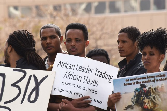 Sudanese and Etritrean asylum seekers demonstrate against Israel's plan to forcibly expel them outside the Embassy of Rwanda in Herzliya, Israel, on February 7. File Photo by Debbie Hill/UPI