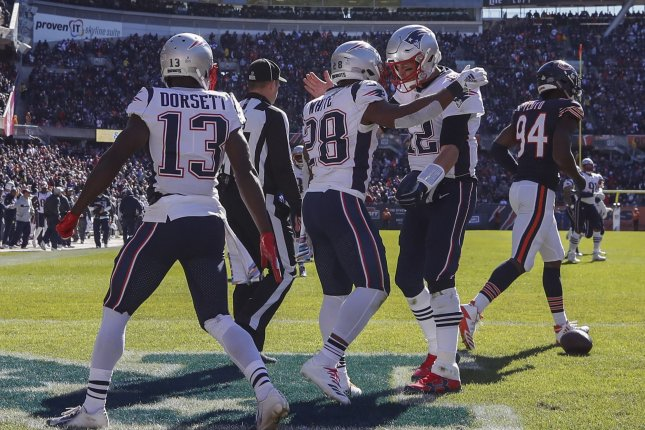 New England Patriots running back James White (28) celebrates with quarterback Tom Brady (12) after scoring a touchdown against the Chicago Bears during the first half on Sunday at Soldier Field in Chicago. Photo by Kamil Krzaczynski/UPI