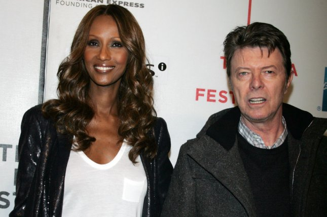 Iman (L), pictured with David Bowie, said she still considers the late singer her husband. File Photo by Laura Cavanaugh/UPI