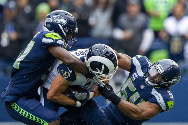 Seattle Seahawks linebackers Barkevious Mingo (51) and Bobby Wagner (51) team up to tackle Los Angeles Rams wide receiver Cooper Kupp (18) on October 7 in Seattle. File Photo by Jim Bryant/UPI