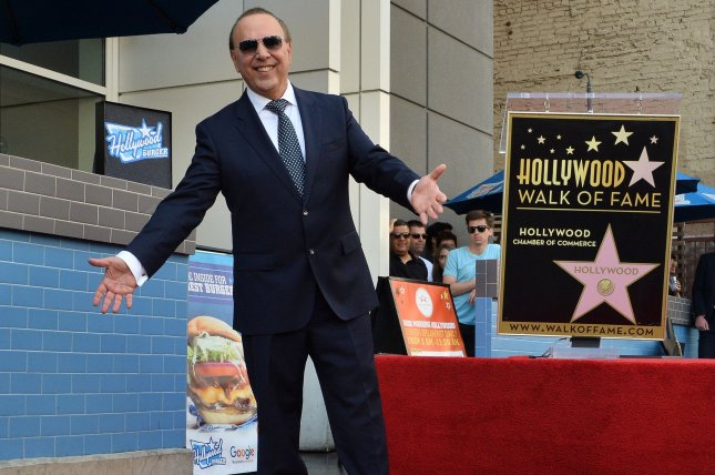 Music industry mogul and executive Tommy Mottola stands atop his star the Hollywood Walk of Fame in Los Angeles. Photo by Jim Ruymen/UPI