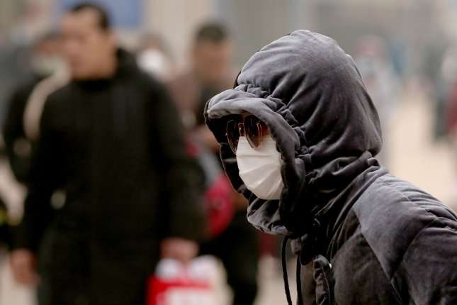 Chinese people head to a bus station wearing protective masks in Beijing in January, as the coronavirus became a threat to the city. Photo by Stephen Shaver/UPI