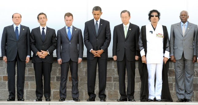 (L-R) Prime Minister Silvio Berlusconi, French President Nicolas Sarkozy, Russian President Dmitriy Medvedev, US President Barack Obama, UN Secretary General Ban Ki-Moon, African Union President Libyan Leader Moammar Gadhafi and Angolan President JosŽ Eduardo dos Santos are shown on the last working day of the G8 (Group of Eight) Summit in L'Aquila, Italy on July 10, 2009, before unveiling the plaque commemorating the earthquake in the main square of the Guardia di Finanza Inspectors' School where the Summit was held. (UPI Photo/Ettore Ferrari/G8Website)