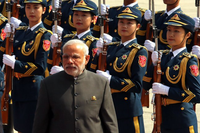 Indian Prime Minister Narendra Modi attends a welcoming ceremony at the Great Hall of the People in Beijing on May 15, 2015. Modi is taking the lead on India's global yoga initiative and is hoping to set a new world record for the largest single yoga class on June 21. Photo by Stephen Shaver/UPI