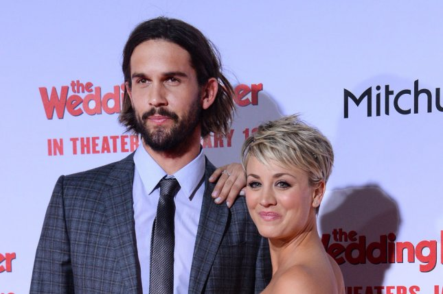 Kaley Cuoco (R) and Ryan Sweeting at the Los Angeles premiere of 'The Wedding Ringer' on Jan. 6. The actress covered up her wedding date tattoo Tuesday. File Photo by Jim Ruymen/UPI