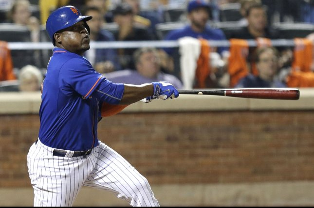 Former New York Mets IF Juan Uribe hits a 2-run home run in the 7th inning against the New York Yankees at Citi Field in New York City on September 18, 2015. Photo by John Angelillo/UPI