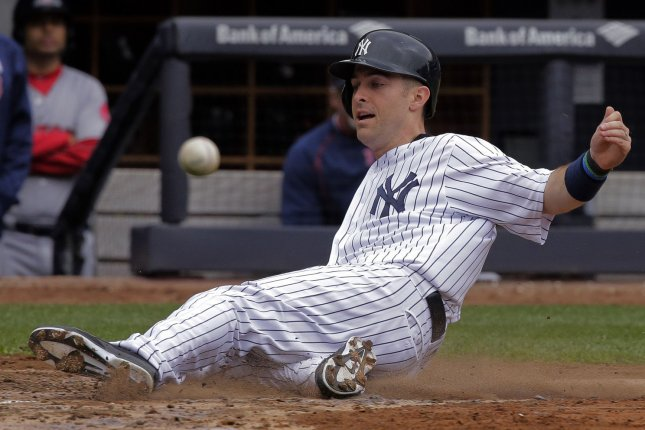 New York Yankees runner Dustin Ackley beats the throw as he scores from first base on a bases-loaded double by Yankees batter Didi Gregorius against the Boston Red Sox in the fourth inning of their American League MLB game at Yankee Stadium in New York City, May 7, 2016. Photo by Ray Stubblebine/UPI