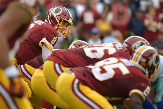 Washington Redskins quarterback Kirk Cousins prepares to hike the ball against the Dallas Cowboys at FedEx Field in Landover, Maryland on September 18, 2016. Photo by Kevin Dietsch/UPI