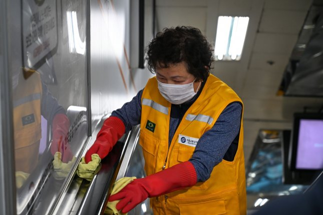 A worker cleans inside the Myeongdond subway station in Seoul, South Korea, to protect against the coronavirus pandemic. File Photo by Thomas Maresca/UPI