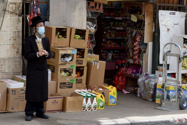 An ultra-Orthodox Jew wears a protective mask against the coronavirus in the Mea Shearim neighborhood in Jerusalem, Israel, on Thursday. Officials say cases have spiked in ultra-Orthodox communities. Photo by Debbie Hill/UPI