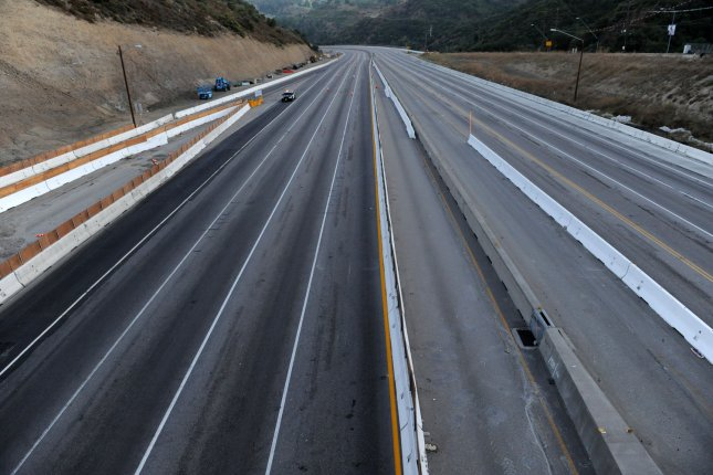 One of the busiest freeways in California, the 405, stands vacant as workers demolish the south side of Mulholland overpass on the freeway during the 53-hour total freeway closure. The massive traffic disruptions expected throughout the region did not materialize. The bridge is being demolished as part of a $1 billion project to add carpool lanes and make other improvements along the 405 freeway from Orange County to the city of San Fernando. UPI/Jim Ruymen