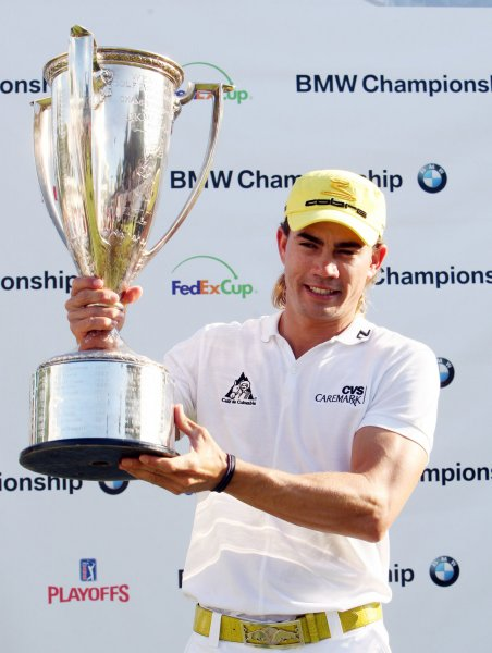 PGA golfer Camilo Villegas holds up the championship trophy after winning the BMW Championship at Bellerive Country Club in Town and Country, Missouri on September 7, 2008. (UPI Photo/Bill Greenblatt)