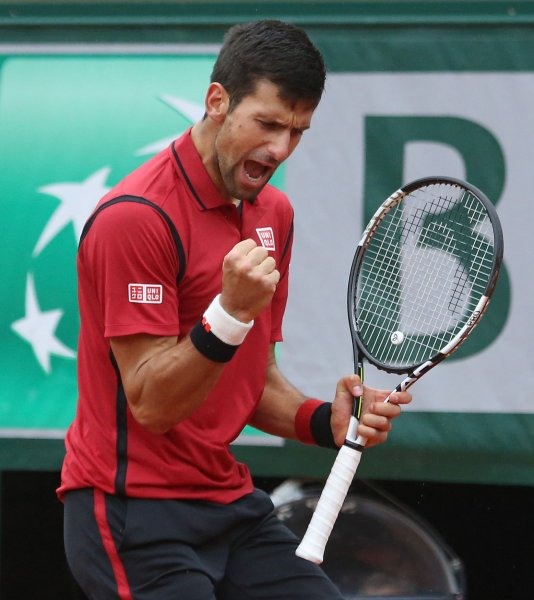 Novak Djokovic of Serbia reacts after a shot during his French Open men's quarterfinal match against Tomas Berdych of the Czech Republic at Roland Garros in Paris on June 2, 2016. Djokovic defeated Berdych 6-3, 7-5, 6-3 to advance to the semifinals. Photo by David Silpa/UPI