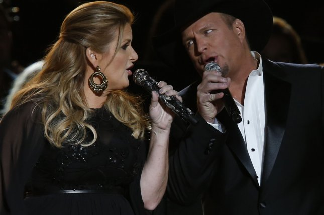 Trisha Yearwood and Garth Brooks sing at the 2016 Country Music Awards at Bridgestone Arena in Nashville, Tennessee on November 2, 2016. Photo by John Sommers II/UPI