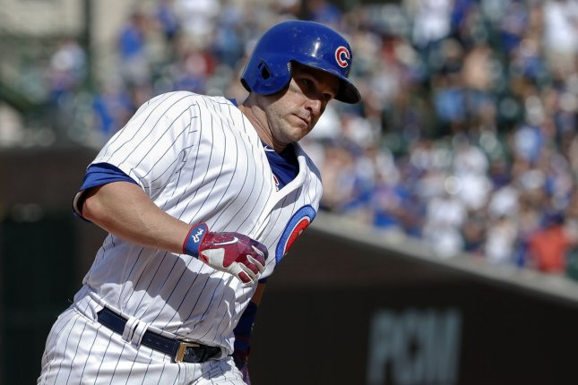 Chicago Cubs Miguel Montero runs the bases after hitting a solo home run off Colorado Rockies relief pitcher Chad Qualls in the eight inning at Wrigley Field on June 11, 2017 in Chicago. File photo by Kamil Krzaczynski/UPI