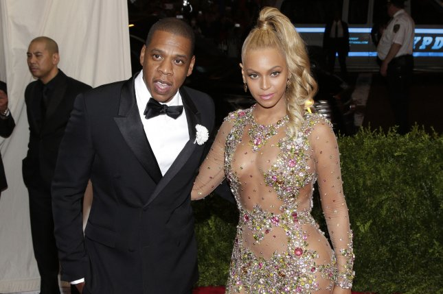 Jay-Z -- seen here with his wife Beyoncé at the Costume Institute Benefit in New York City on May 4, 2015 -- was honored at the Pre-Grammy Gala Saturday night. File Photo by John Angelillo/UPI