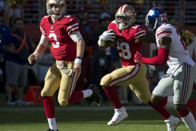 San Francisco 49ers running back Carlos Hyde (28) runs for 28 yards in the first quarter against the New York Giants on November 12, 2017 at Levi's Stadium in Santa Clara, California. Photo by Terry Schmitt/UPI