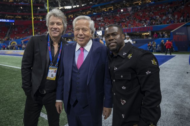 Left to right, Jon Bon Jovi, New England Patriots owner Robert Kraft, and Kevin Hart watch pregame activities at Super Bowl LIII on Sunday. Photo by Tasos Katopodis/UPI