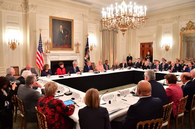 President Donald Trump participates in an American Workforce Policy Advisory Board meeting at the White House in Washington, D.C., on Wednesday. Photo by Kevin Dietsch/UPI