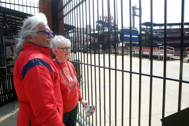 The MLBPA says team owners are depriving fans, like Janet Daniels (R) and her son Stephen, of baseball games as the two parties negotiate a way to return to the field in 2020 amid the coronavirus pandemic. File Photo by Bill Greenblatt/UPI