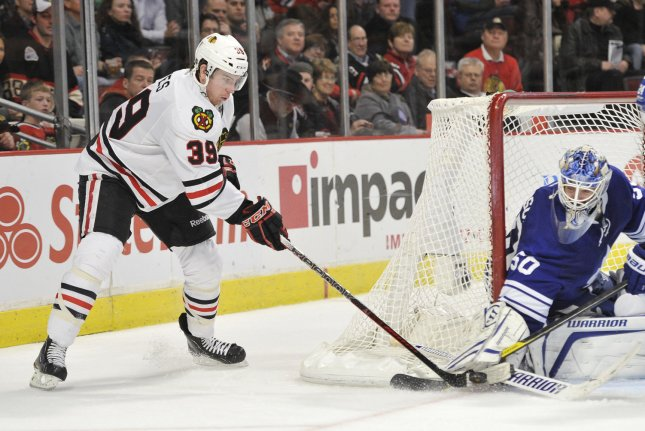 Former Chicago Blackhawks forward Jimmy Hayes (L), shown Feb. 29, 2012, recorded 54 goals and 55 assists over 334 career NHL games. File Photo by Brian Kersey/UPI
