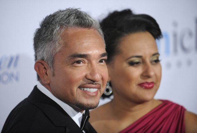 Cesar Milan (L) and wife Ilusion attend the 24th Annual Imagen Awards in Los Angeles on August 21, 2009. UPI/ Phil McCarten