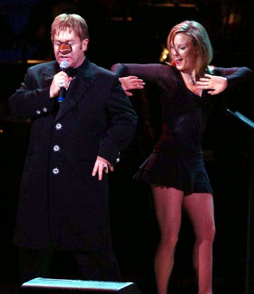 Sir Elton John performs with a fake bird beak during his Woody Woodpecker Song at the 12th annual RainForest Foundation Concert held on April 21, 2004 at New York's Carnegie Hall. (UPI/Ezio Petersen)