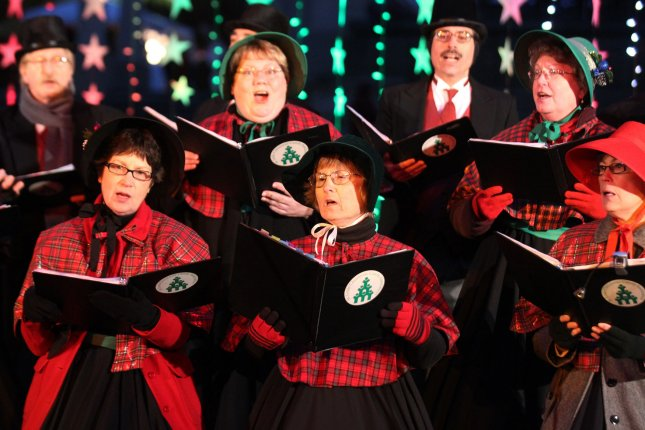 Carolers sing before holiday lights are turned on throughout the city of St. Louis. UPI/Bill Greenblatt