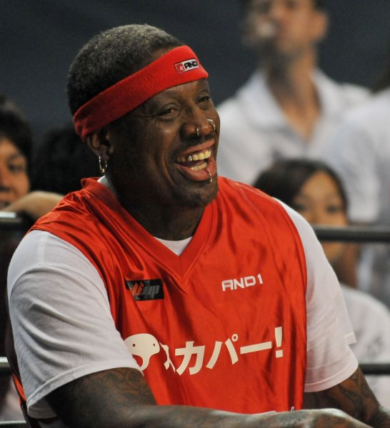 Dennis Rodman sits on the bench during the game of street basketball against Japan's Somecity goes to S2E at the Ariake Colosseum in Tokyo, Japan, on August 19, 2010. UPI/Keizo mori