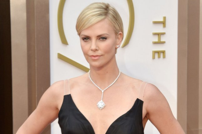 Charlize Theron arrives on the red carpet at the 86th Academy Awards at Hollywood & Highland Center in the Hollywood section of Los Angeles on March 2, 2014. UPI/Kevin Dietsch