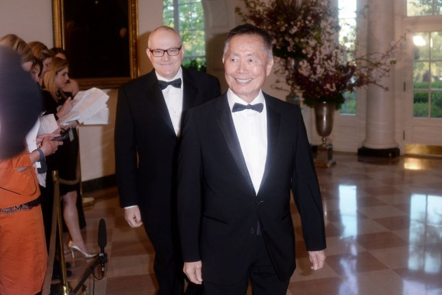 George Takei (R) and Brad Takei arrive for the State Dinner in honor of Japanese Prime Minister Shinzo Abe at the White House in Washington, D.C. on April 28, 2016. Takei has spoken out over his oringal 'Star Trek character Hikaru Sulu being portrayed as gay in the new film, Star Trek Beyond saying it's really unforunate. Pool photo by Olivier Douliery/UPI