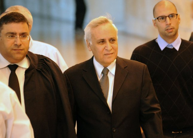 Former Israeli President Moshe Katsav, center, was convicted of rape and other offences in 2011, and served five years of a seven-year sentence before he was paroled Wednesday. File Photo by Debbie Hill/UPI